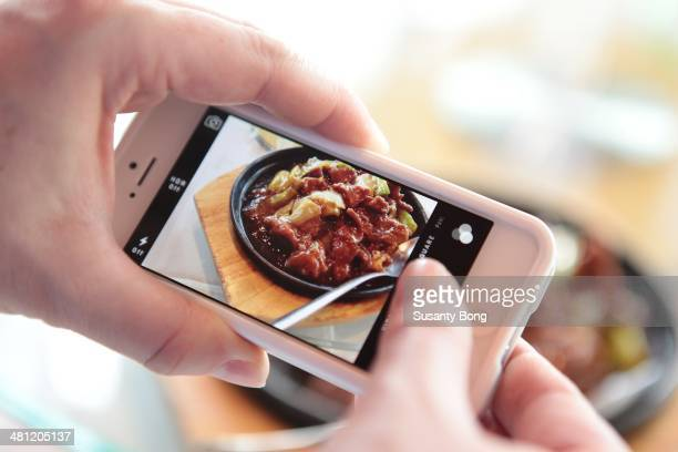 Taking picture of a dish in the restaurant