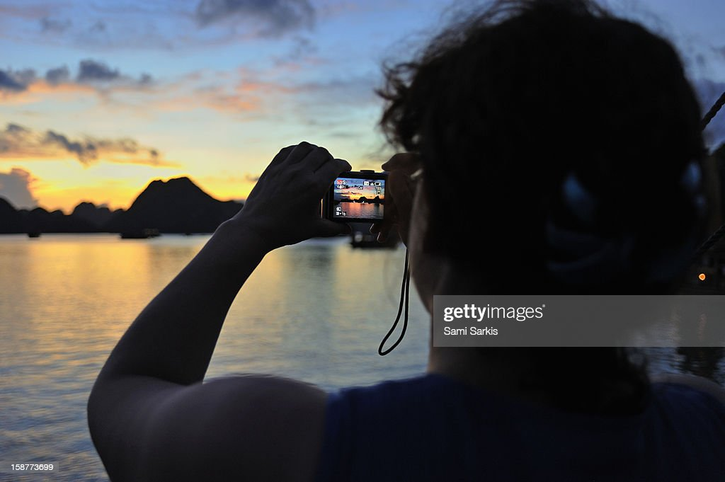 Taking picture of Halong Bay at sunset : Stock Photo