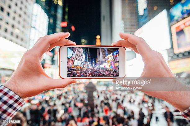 Taking pictures at Times Square at night, New York