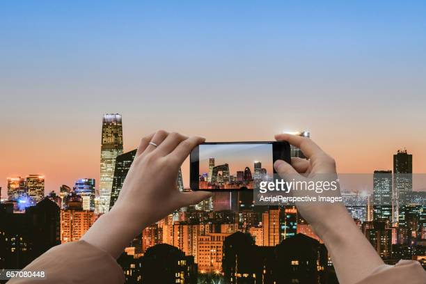 Taking pictures with smartphone of Beijing CBD