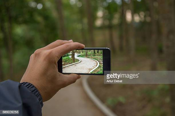 Taking pictures with smartphone on snake path