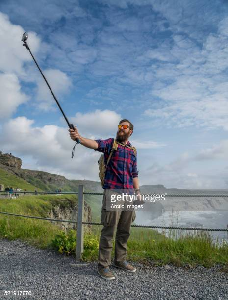 Taking self portraits with a monopod at Gullfoss Waterfalls in Iceland