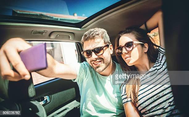 Taking selfie in a car.