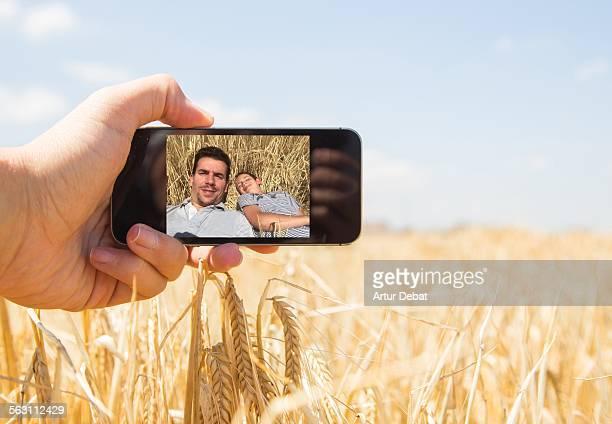 Taking selfie with my nephew on wheat field.