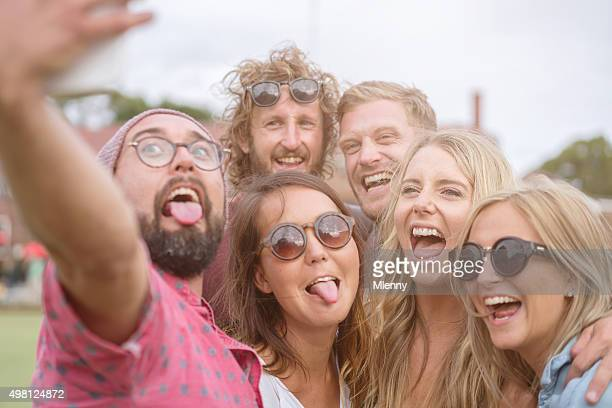 Taking Selfies Best Friends having fun stick out the tongues