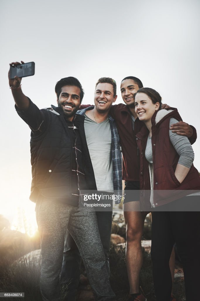 Taking selfies over a breathtaking view : Stock Photo