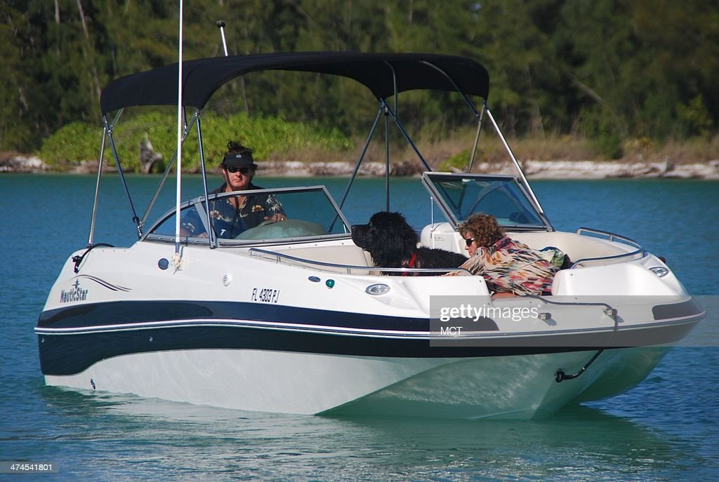 Taking the family out for a boat ride in Naples, Fla., means bringing the dog along as well.
