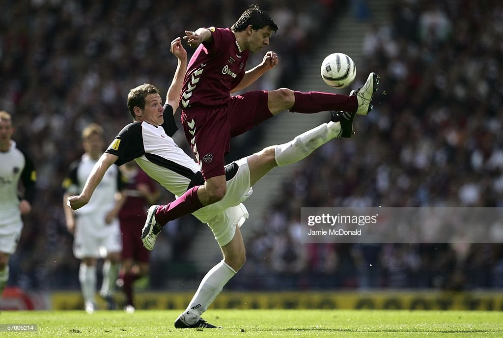 Takis Fyssas of Hearts battles with Kenny Deuchar of Gretna during the Tennents Scottish Cup Final between Heart of Midlothian and Gretna at Hampden Park on May 13 2006, in Glasgow, Scotland.