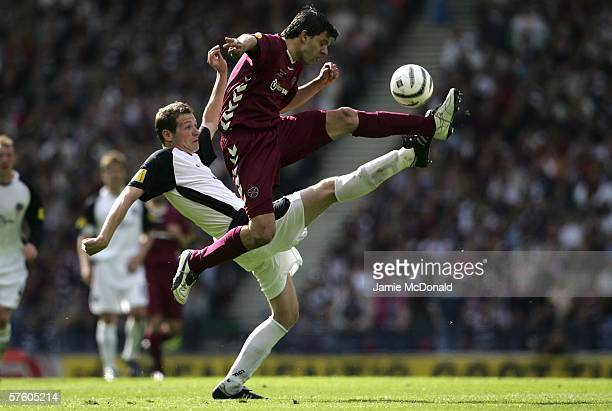 Takis Fyssas of Hearts battles with Kenny Deuchar of Gretna during the Tennents Scottish Cup Final between Heart of Midlothian and Gretna at Hampden...