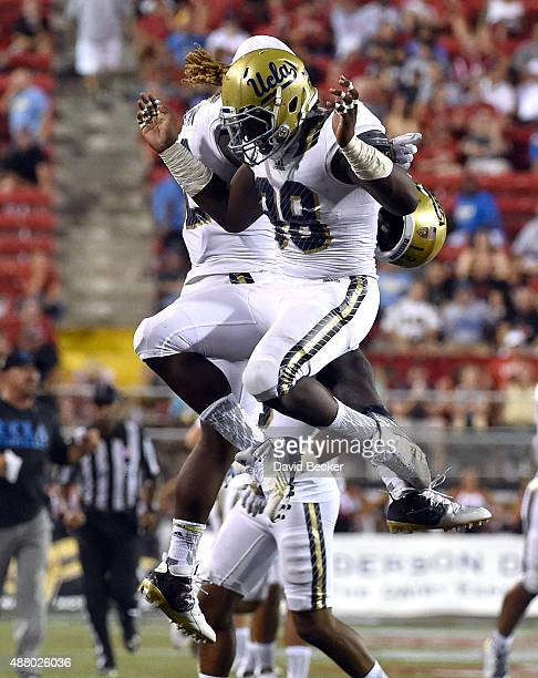Takkarist McKinley and Jaleel Wadood of the UCLA Bruins celebrate blocking a punt during their game against the UNLV Rebels at Sam Boyd Stadium on...