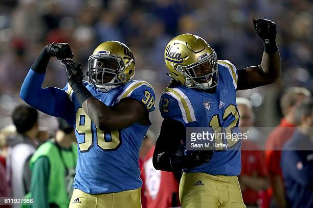 Takkarist McKinley and Jayon Brown of the UCLA Bruins react to a tackle during the second half of a game against the Arizona Wildcats at the Rose...