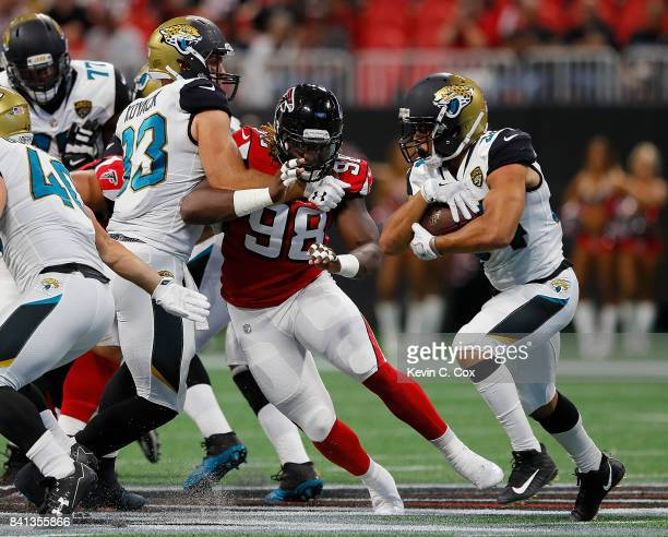 Takkarist McKinley of the Atlanta Falcons gives chases to Jonathan Grimes of the Jacksonville Jaguars at MercedesBenz Stadium on August 31 2017 in...