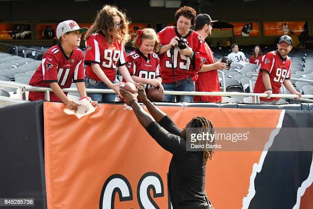 Takkarist McKinley of the Atlanta Falcons signs autographs prior to the game against the Chicago Bears at Soldier Field on September 10 2017 in...