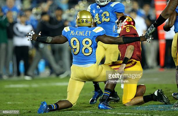 Takkarist McKinley of the UCLA Bruins celebrates after sacking quarterback Cody Kessler of the USC Trojans in the third quarter at the Rose Bowl on...