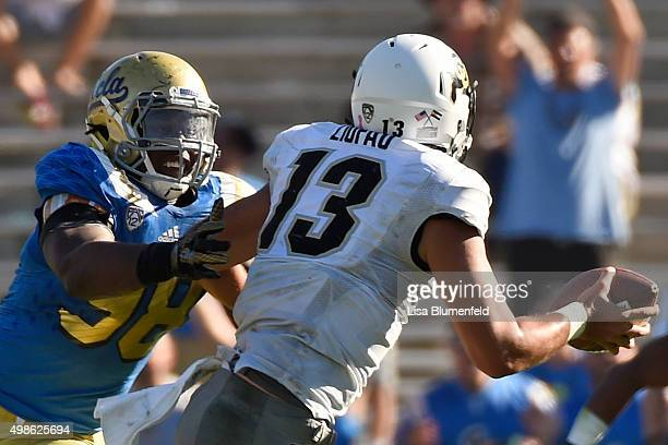 Takkarist McKinley of the UCLA Bruins defends quarterback Sefo Liufau the Colorado Buffaloes in the fourth quarter at Rose Bowl on October 31 2015 in...