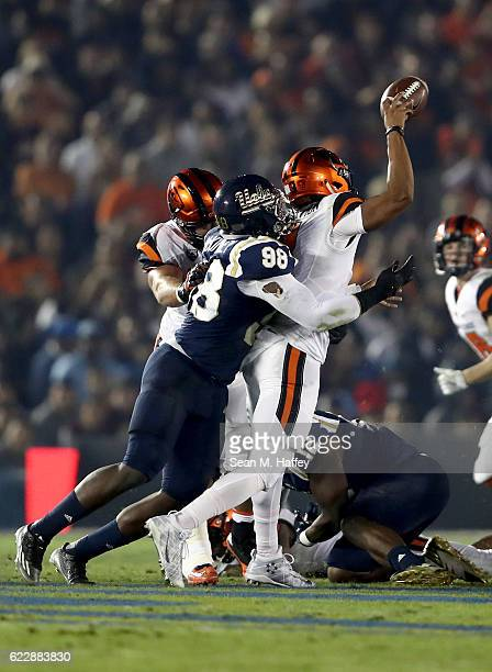 Takkarist McKinley of the UCLA Bruins sacks Marcus McMaryion of the Oregon State Beavers during the first half of a game at The Rose Bowl on November...