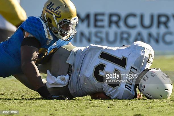 Takkarist McKinley of the UCLA Bruins sacks quarterback Serfo Liufau the Colorado Buffaloes in the fourth quarter at Rose Bowl on October 31 2015 in...