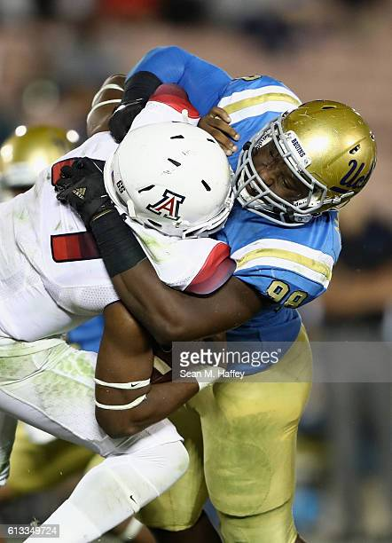 Takkarist McKinley of the UCLA Bruins tackles Khalil Tate of the Arizona Wildcats during the second half of a game at the Rose Bowl on October 1 2016...