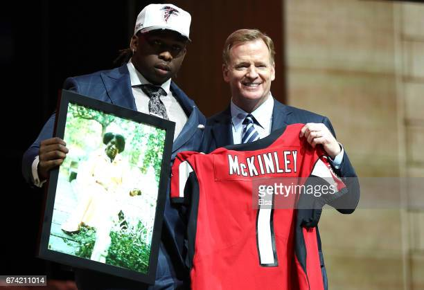 Takkarist McKinley of UCLA poses with Commissioner of the National Football League Roger Goodell after being picked overall by the Atlanta Falcons...