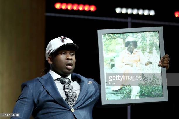 Takkarist McKinley of UCLA reacts after being picked overall by the Atlanta Falcons during the first round of the 2017 NFL Draft at the Philadelphia...