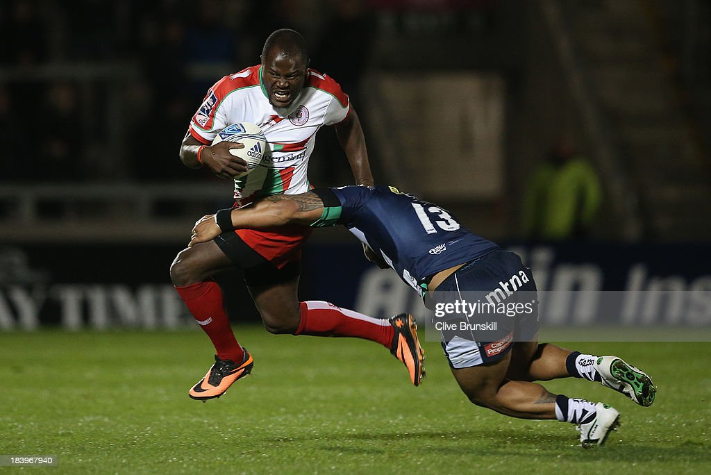 Taku Ngwenya of Biarritz Olympique is tackled by Johnny Leota of Sale during the Amlin Challenge Cup match between Sale Sharks and Biarritz Olympique...