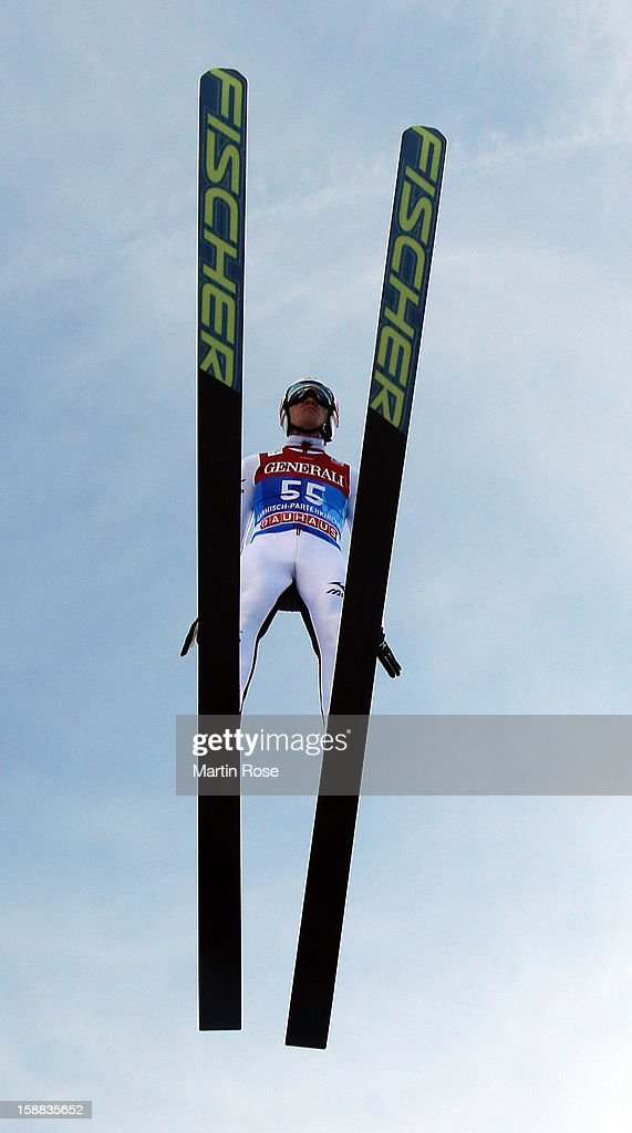 Taku Takeuchi of Japan competes during the trial round for the FIS Ski Jumping World Cup event of the 61st Four Hills ski jumping tournament at Olympiaschanze on December 31, 2012 in Garmisch-Partenkirchen, Germany.