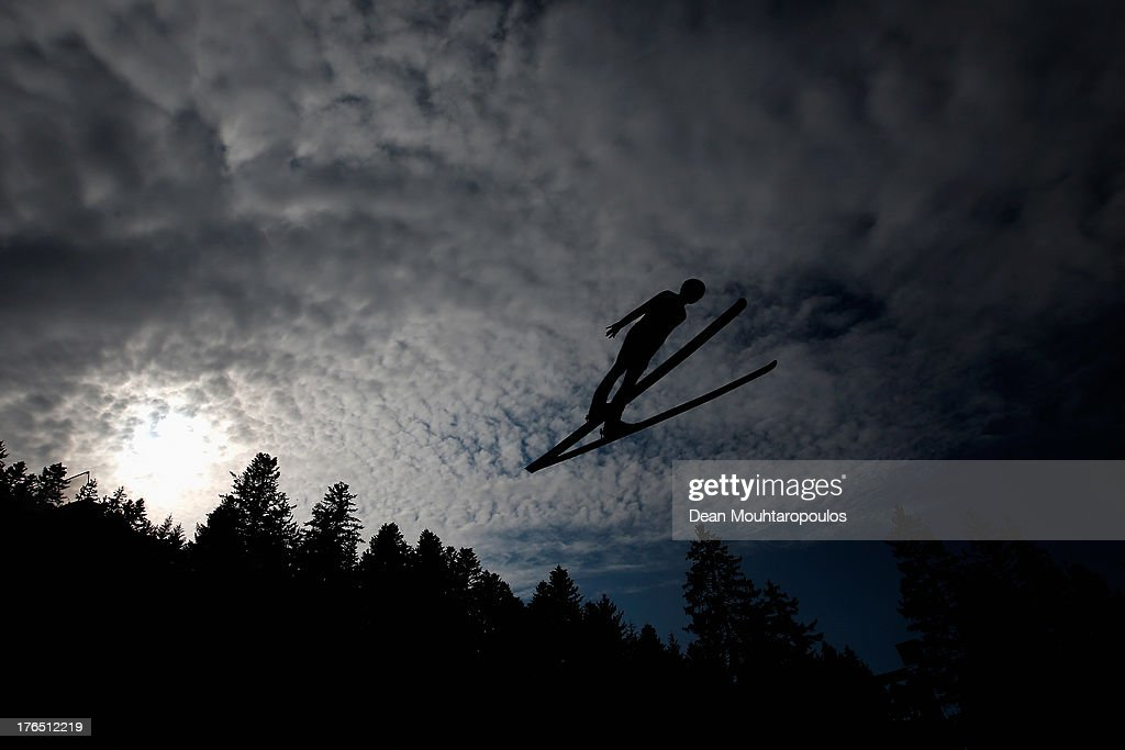 Taku Takeuchi of Japan competes in the FIS Ski Jumping Grand Prix Mixed Team Trial Round on August 14, 2013 in Courchevel, France.
