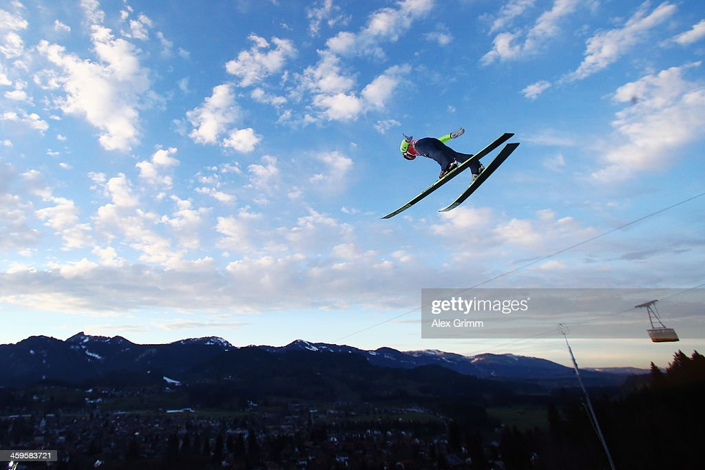 Taku Takeuchi of Japan soars through the air during the training round on day 1 of the Four Hills Tournament Ski Jumping event at Schattenberg-Schanze on December 28, 2013 in Oberstdorf, Germany.