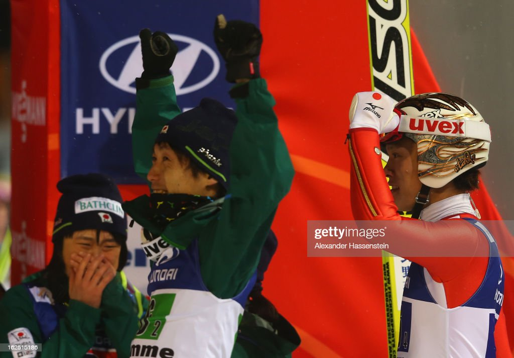 Taku Takeuchi Sara Takanashi and Daiki Ito of Japan celebrate victory during the Mixed Team Ski Jumping HS 106 Final Round at the FIS Nordic World...