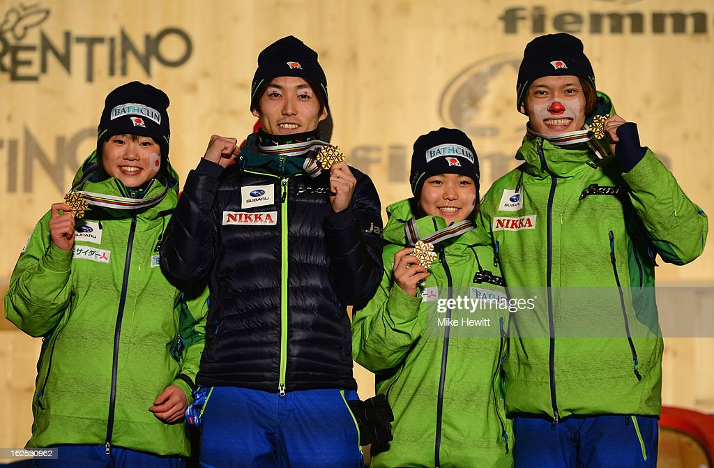 Taku Takeuchi Sara Takanashi Daiki Ito and Yuki Ito of Japan celebrate with their Gold medals at the medal ceremony for the Mixed Team Ski Jumping HS...