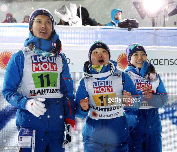 Taku Takeuchi Yuki Ito and Sara Takanashi of Japan watch the second jump of Daiki Ito in the Mixed Team HS100 Normal Hill Ski Jumping during the FIS...
