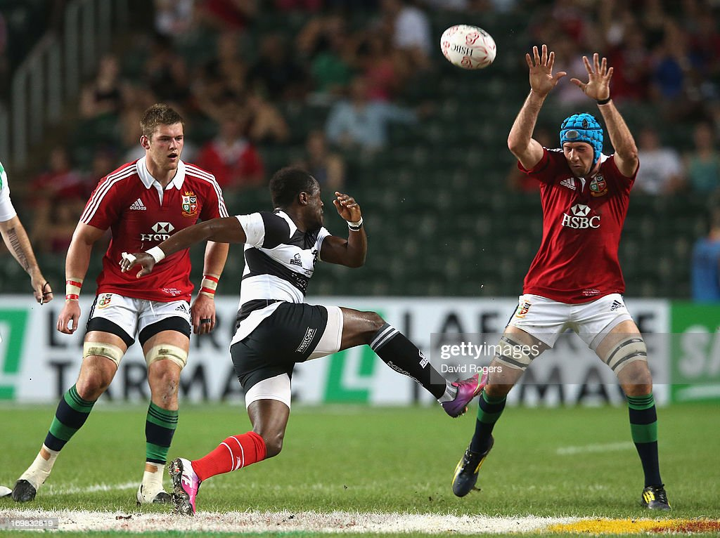 Takudzwa Ngweny of the Barbarians kicks the ball upfield during the match between the British & Irish Lions and the Barbarians at Hong Kong Stadium on June 1, 2013, Hong Kong.