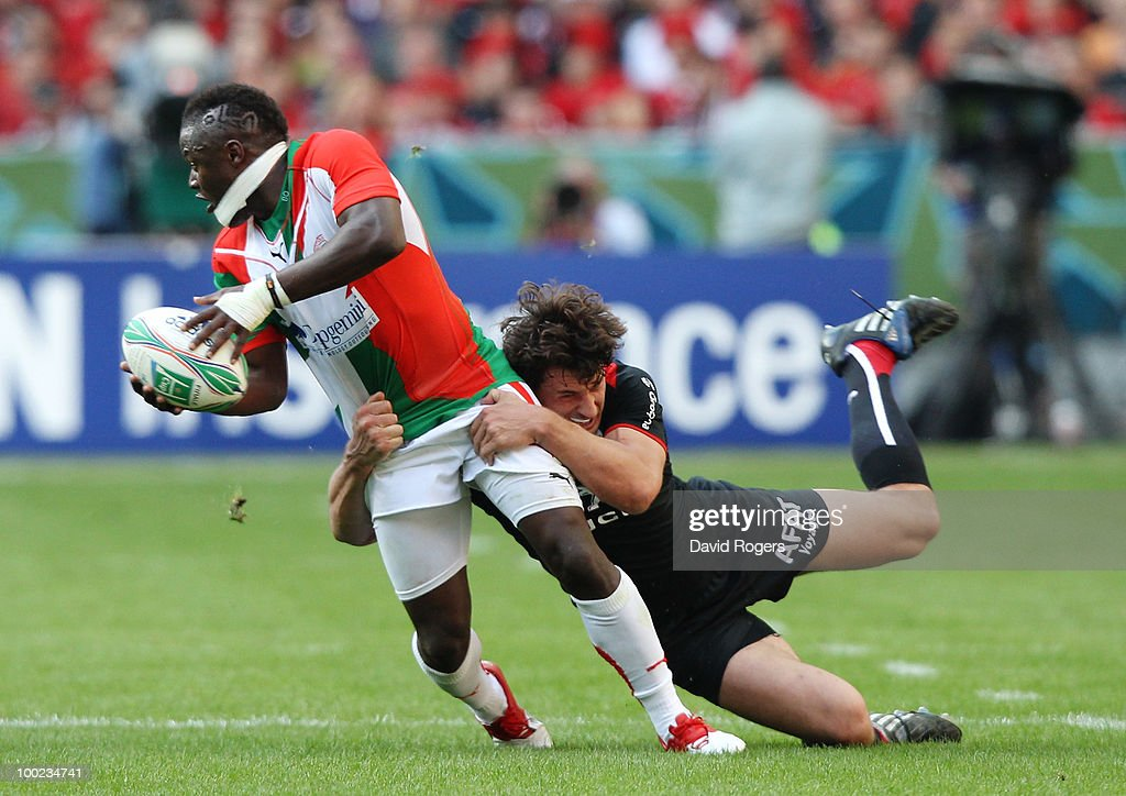 Takudzwa Ngwenya of Biarritz is tackled by Yannick Jauzion of Toulouse during the Heineken Cup Final at Stade France on May 22 2010 in Paris France