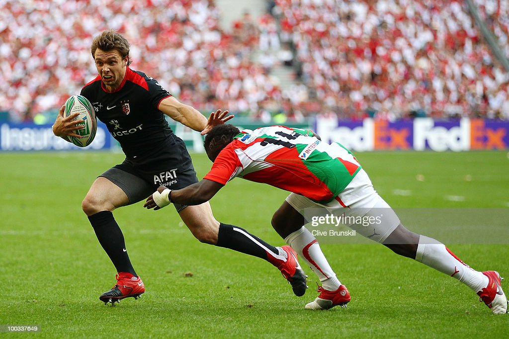 Takudzwa Ngwenya of Biarritz tackles Vincent Clerc of Toulouse during the Heineken Cup Final at Stade France on May 22 2010 in Paris France