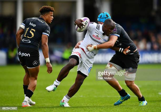 Takudzwa Ngwenya of Brive is tackled by Zach Mercer of Bath during the European Rugby Challenge Cup Quarter Final match between Bath Rugby and Brive...