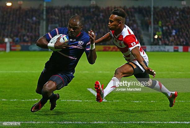 Takudzwa Ngwenya of the United States scores their first try under pressure from Kotaro Matsushima of Japan during the 2015 Rugby World Cup Pool B...