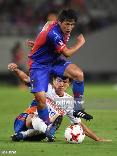 Takuji Yonemoto of FC Tokyo and Kisho Yano of Albirex Niigata compete for the ball during the JLeague J1 match between FC Tokyo and Albirex Niigata...