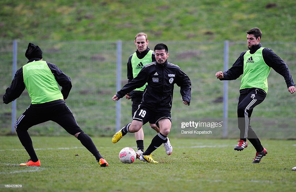 Takuma Abe (C) controles the ball during the training session of VfR Aalen on January 31, 2013 in Aalen, Germany.