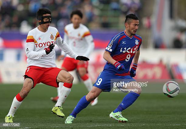 Takuma Abe of Ventforet Kofu and Akira Takeuchi of Nagoya Grampus compete for the ball during the JLeague match between Ventforet Kofu and Nagoya...
