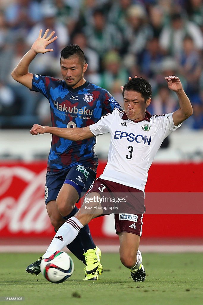 <a gi-track='captionPersonalityLinkClicked' href=/galleries/search?phrase=Takuma+Abe&family=editorial&specificpeople=8013918 ng-click='$event.stopPropagation()'>Takuma Abe</a> of Ventforet Kofu and <a gi-track='captionPersonalityLinkClicked' href=/galleries/search?phrase=Hayuma+Tanaka&family=editorial&specificpeople=1542408 ng-click='$event.stopPropagation()'>Hayuma Tanaka</a> of Matsumoto Yamaga compete for the ball during the J.League match between Ventforet Kofu and Matsumoto Yamaga at Yamanashi Chuo Bank Stadium on July 25, 2015 in Kofu, Yamanashi, Japan.
