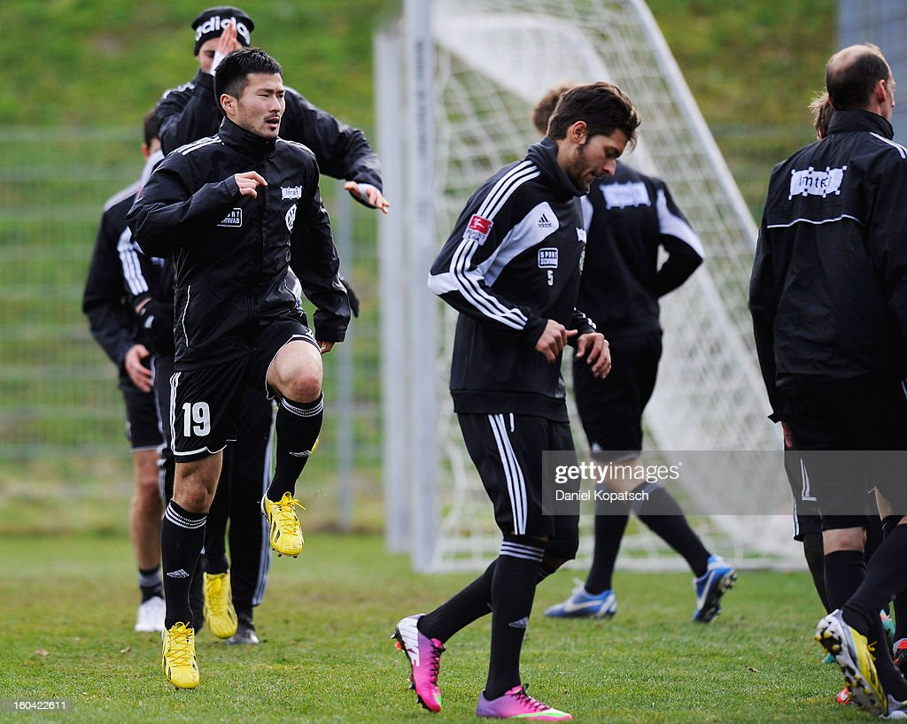Takuma Abe (L) warms up during the training session of VfR Aalen on January 31, 2013 in Aalen, Germany.