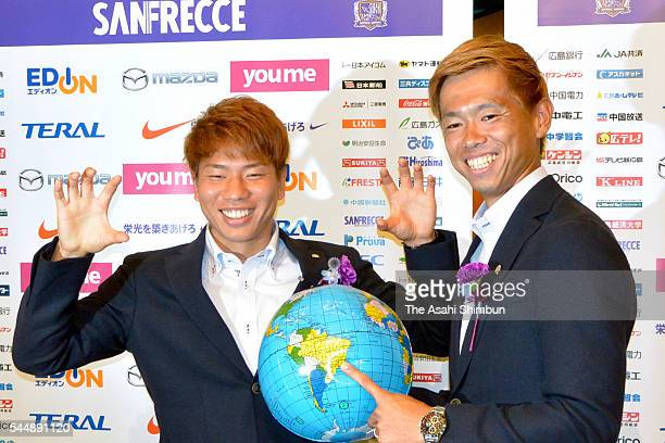 Takuma Asano and Tsukasa Shiotani of Sanfrecce Hiroshima pose for photographs during a press conference after the announcement of Japan Football...