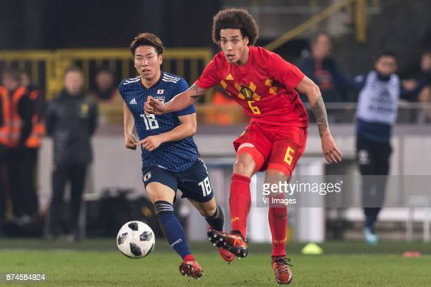 Takuma Asano of Japan Axel Witsel of Belgium during the friendly match between Belgium and Japan on November 14 2017 at the Jan Breydel stadium in...