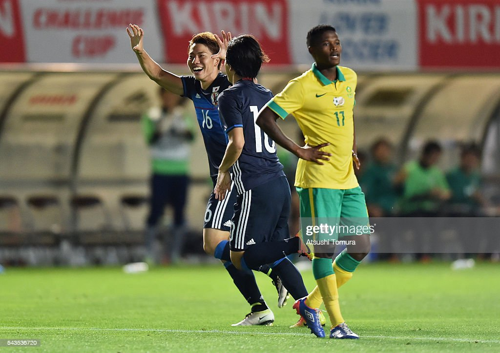Takuma Asano (L) of Japan celebrates scoring his team's fourth goal with his team mate Shinya Yajima (C) during the U-23 international friendly match between Japan and South Africa at the Matsumotodaira Football Stadium on June 29, 2016 in Matsumoto, Nagano, Japan.