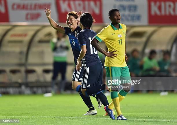 Takuma Asano of Japan celebrates scoring his team's fourth goal with his team mate Shinya Yajima during the U23 international friendly match between...