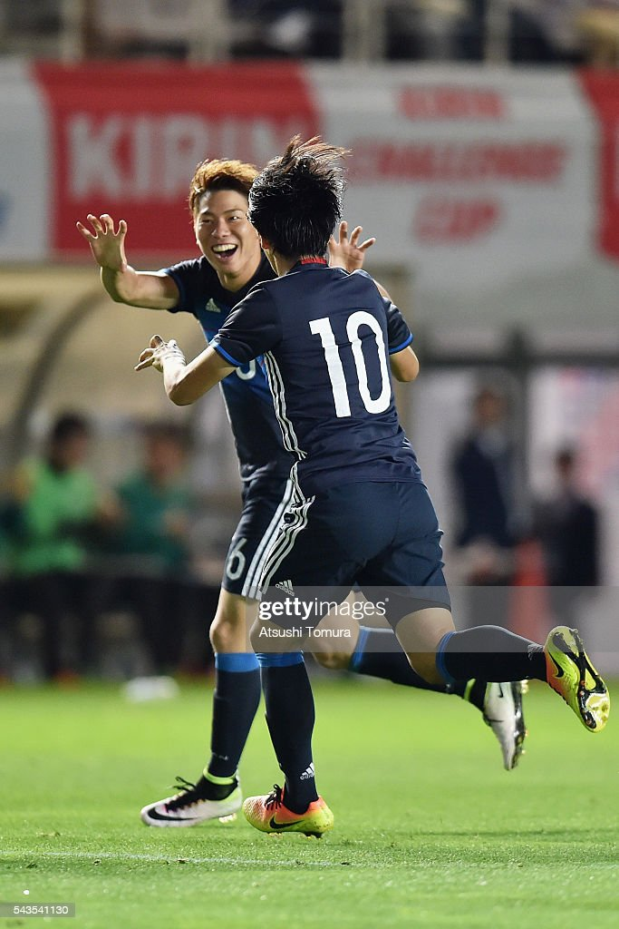 Takuma Asano (L) of Japan celebrates scoring his team's fourth goal with his team mate Shinya Yajima (R) during the U-23 international friendly match between Japan and South Africa at the Matsumotodaira Football Stadium on June 29, 2016 in Matsumoto, Nagano, Japan.