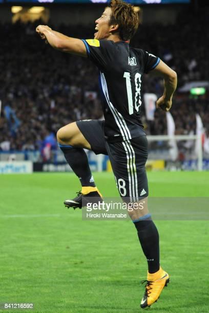 Takuma Asano of Japan celebrates scoring the opening goal during the FIFA World Cup Qualifier match between Japan and Australia at Saitama Stadium on...