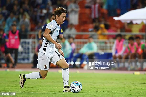Takuma Asano of Japan dribbles during the 2018 FIFA World Cup Qualifier between Thailand and Japan at the Rajamangala National Stadium on September 6...