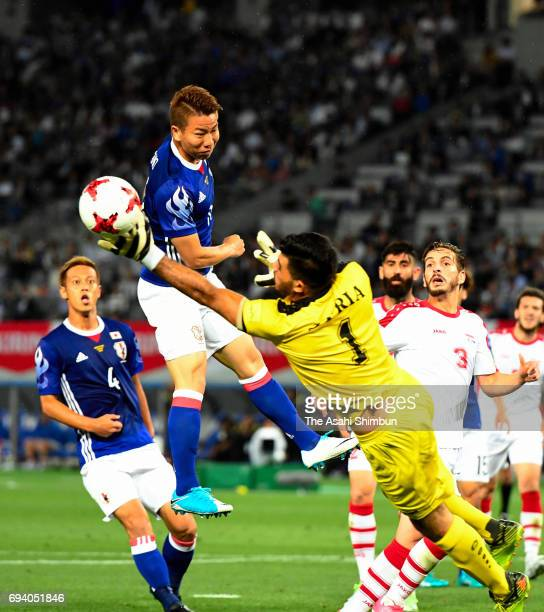Takuma Asano of Japan heads the ball during the international friendly match between Japan and Syria at Tokyo Stadium on June 7 2017 in Chofu Tokyo...