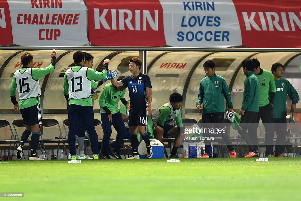 <a gi-track='captionPersonalityLinkClicked' href=/galleries/search?phrase=Takuma+Asano&family=editorial&specificpeople=8776680 ng-click='$event.stopPropagation()'>Takuma Asano</a> of Japan high fives with his team mates after being substituted during the U-23 international friendly match between Japan and South Africa at the Matsumotodaira Football Stadium on June 29, 2016 in Matsumoto, Nagano, Japan.